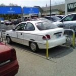 Masshole does not mind a few shopping carts in a parking space